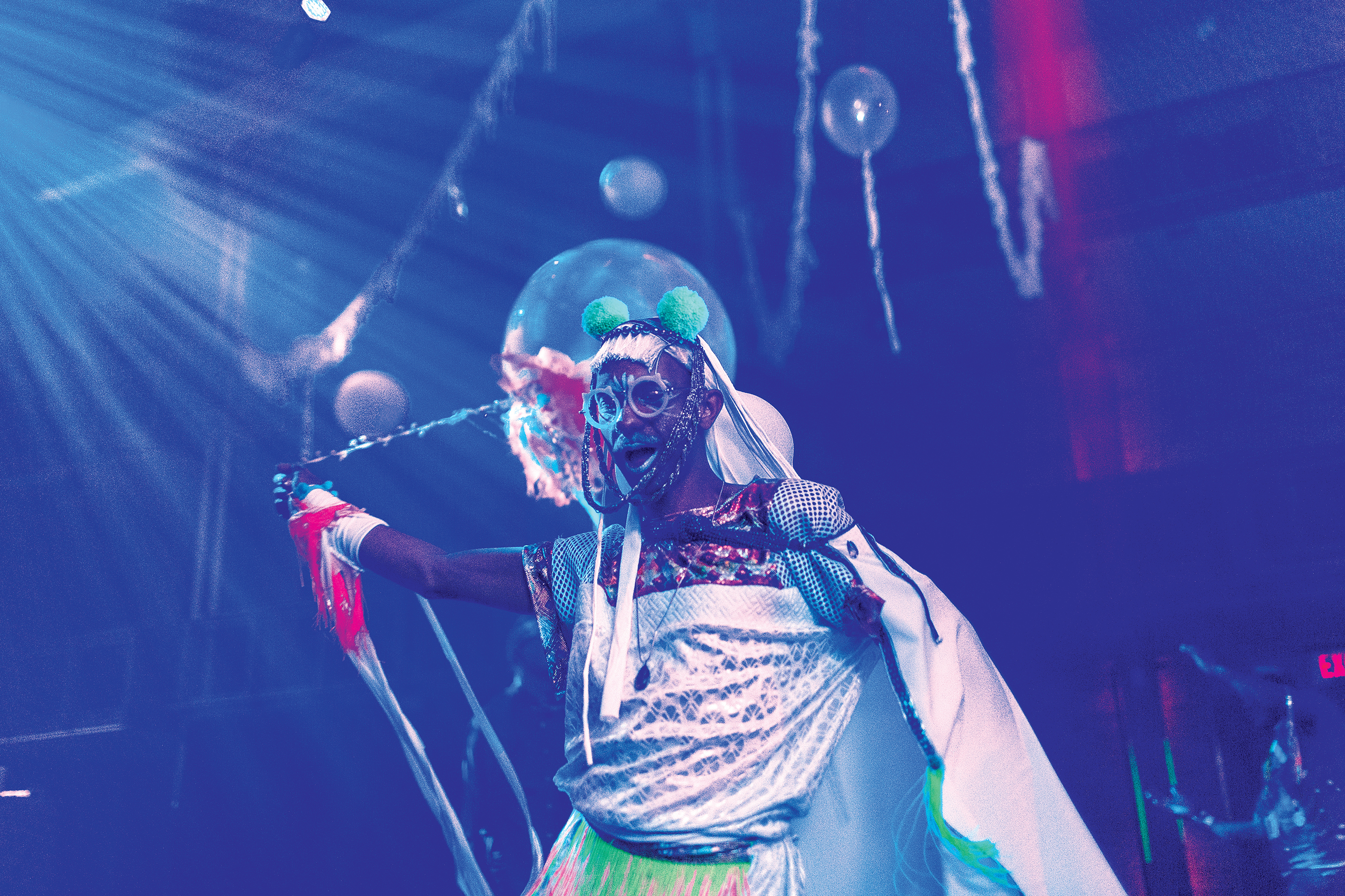 Man in costume performing on stage