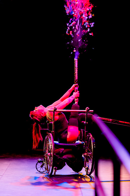 woman in a wheelchair performing onstage