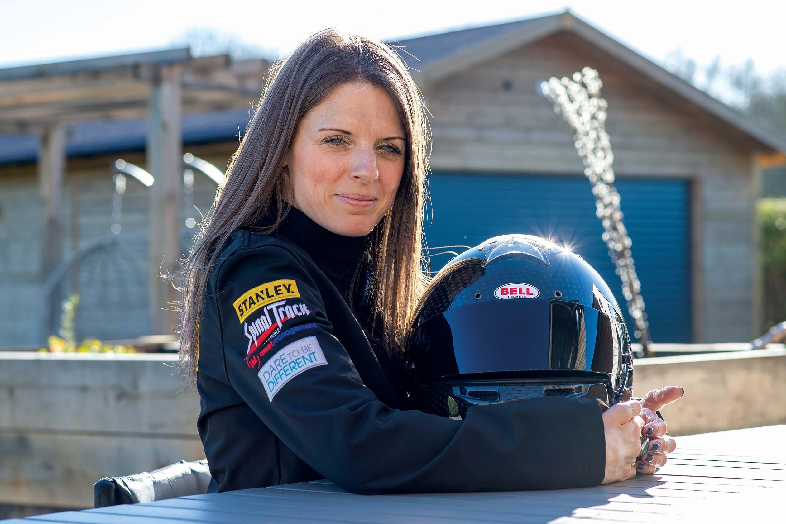 Nathalie McGolin holding a car racing helmet