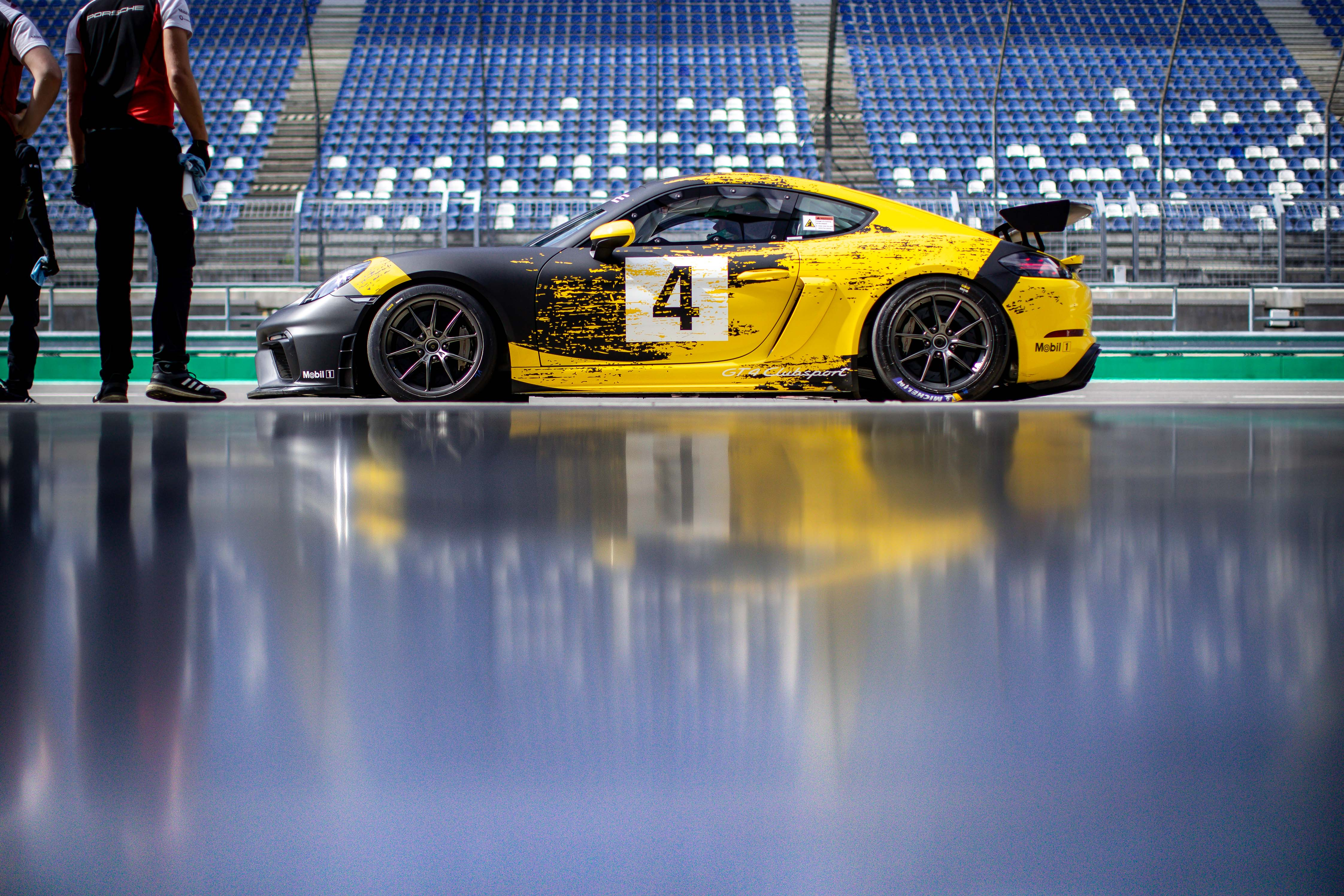 image of the Swiss Racer in yellow and black with the number 4 on the side