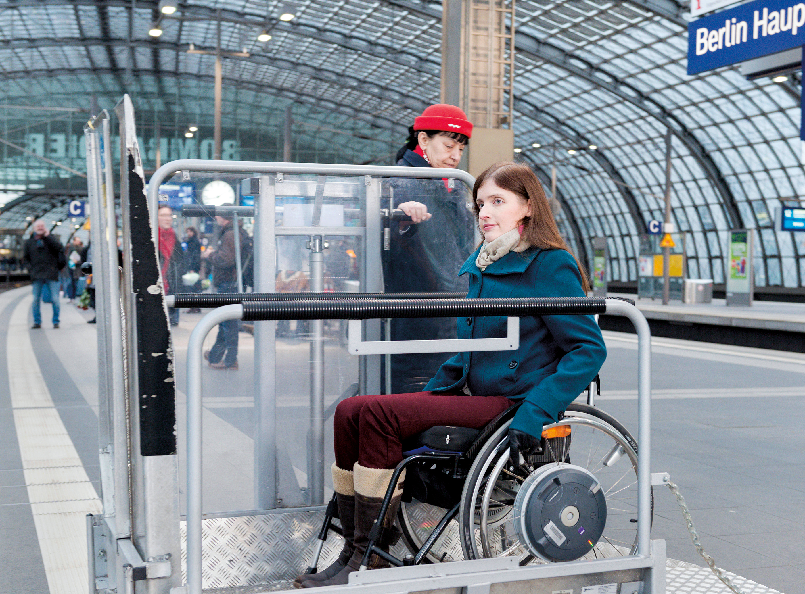 woman in a wheelchair transporter at the airport