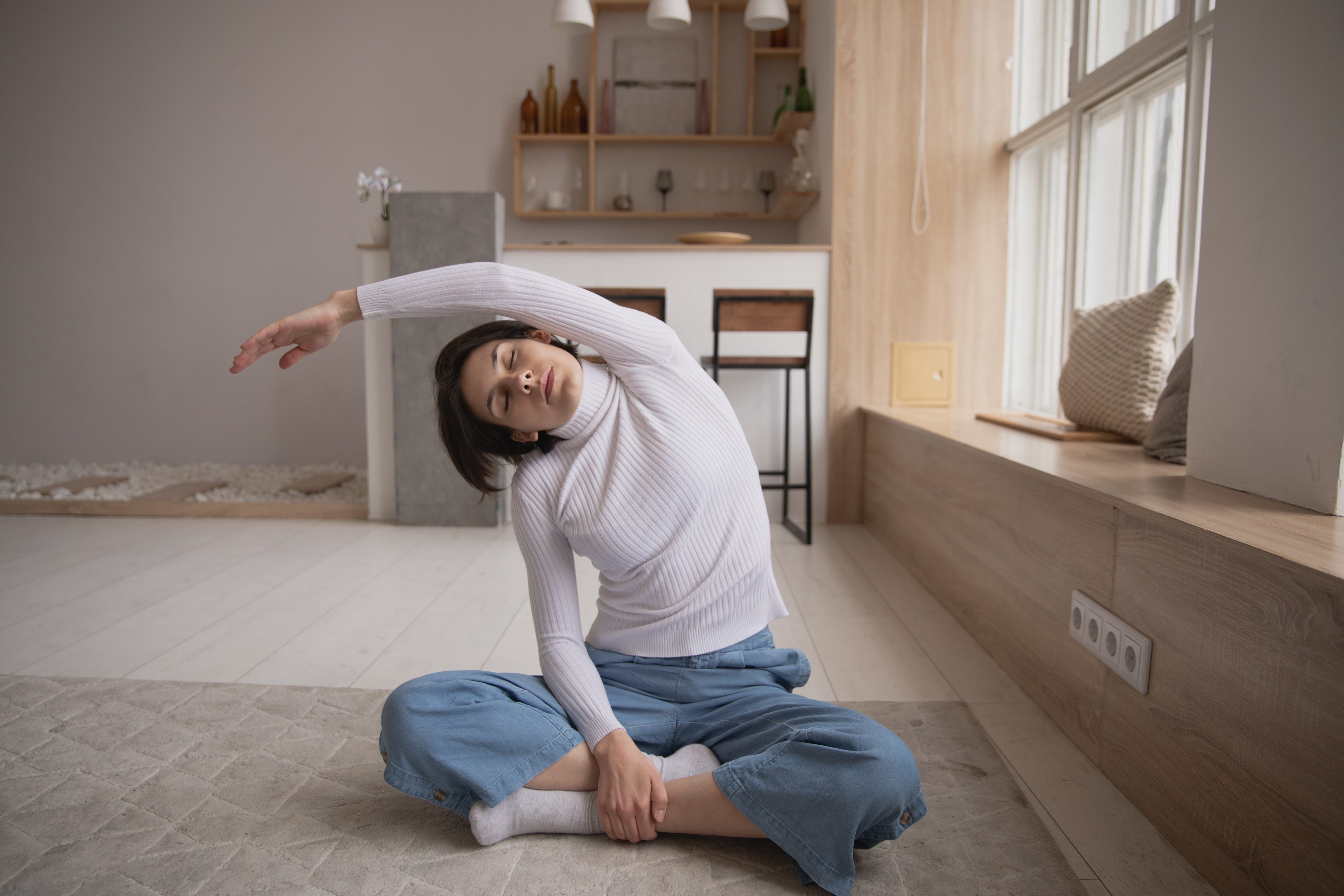 woman stretching on her floor