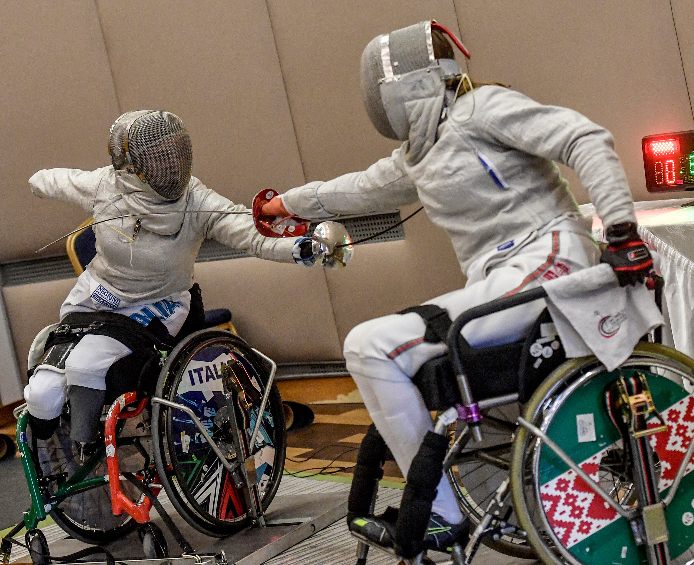 two boys fencing in wheelchairs