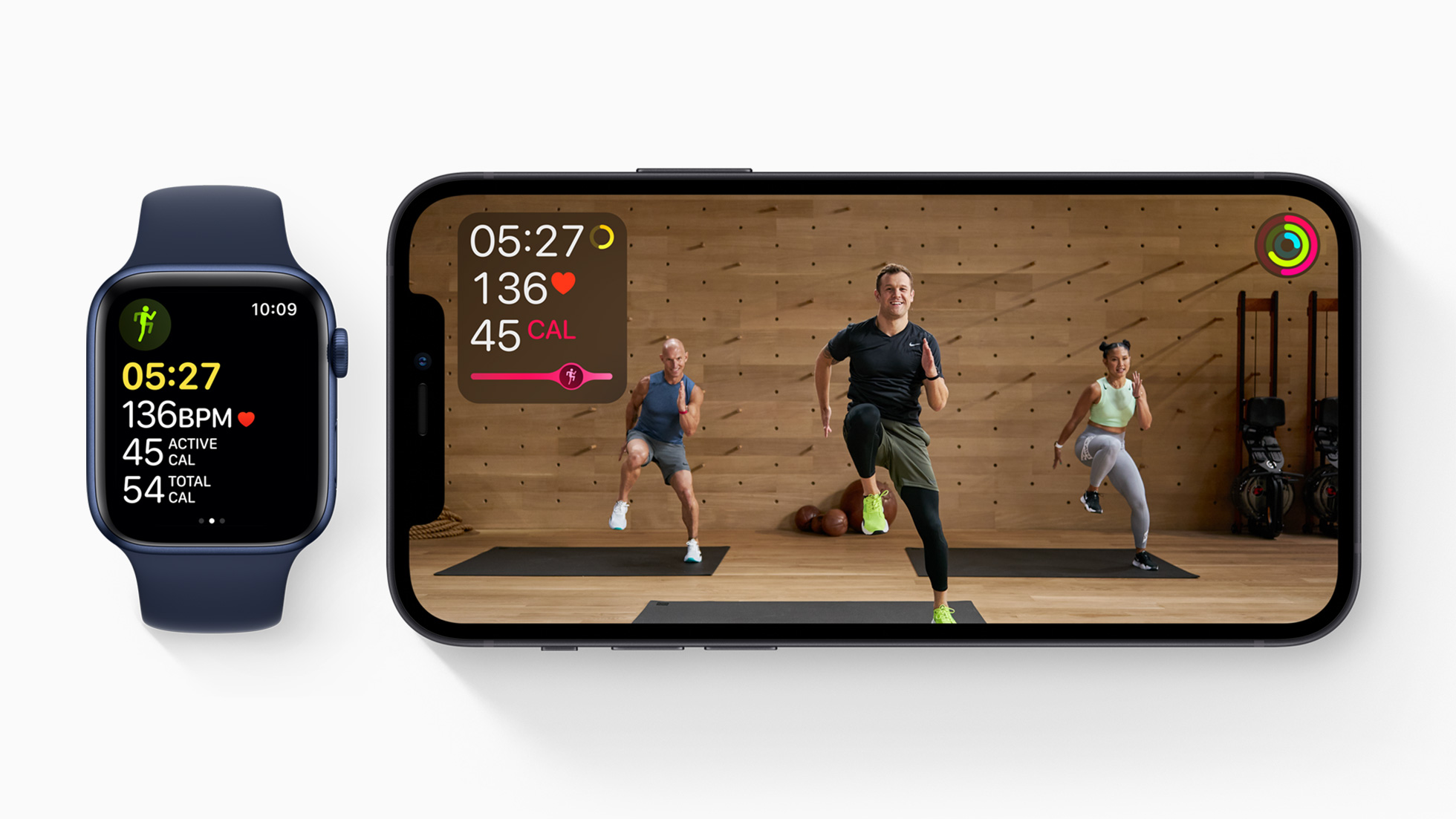 apple watch and apple iPhone with workout program on the screen