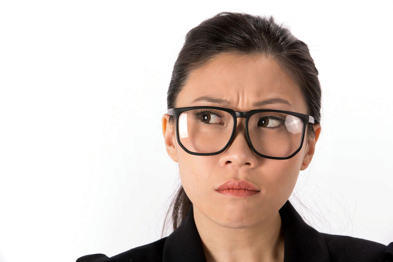 woman looking perplexed in glasses