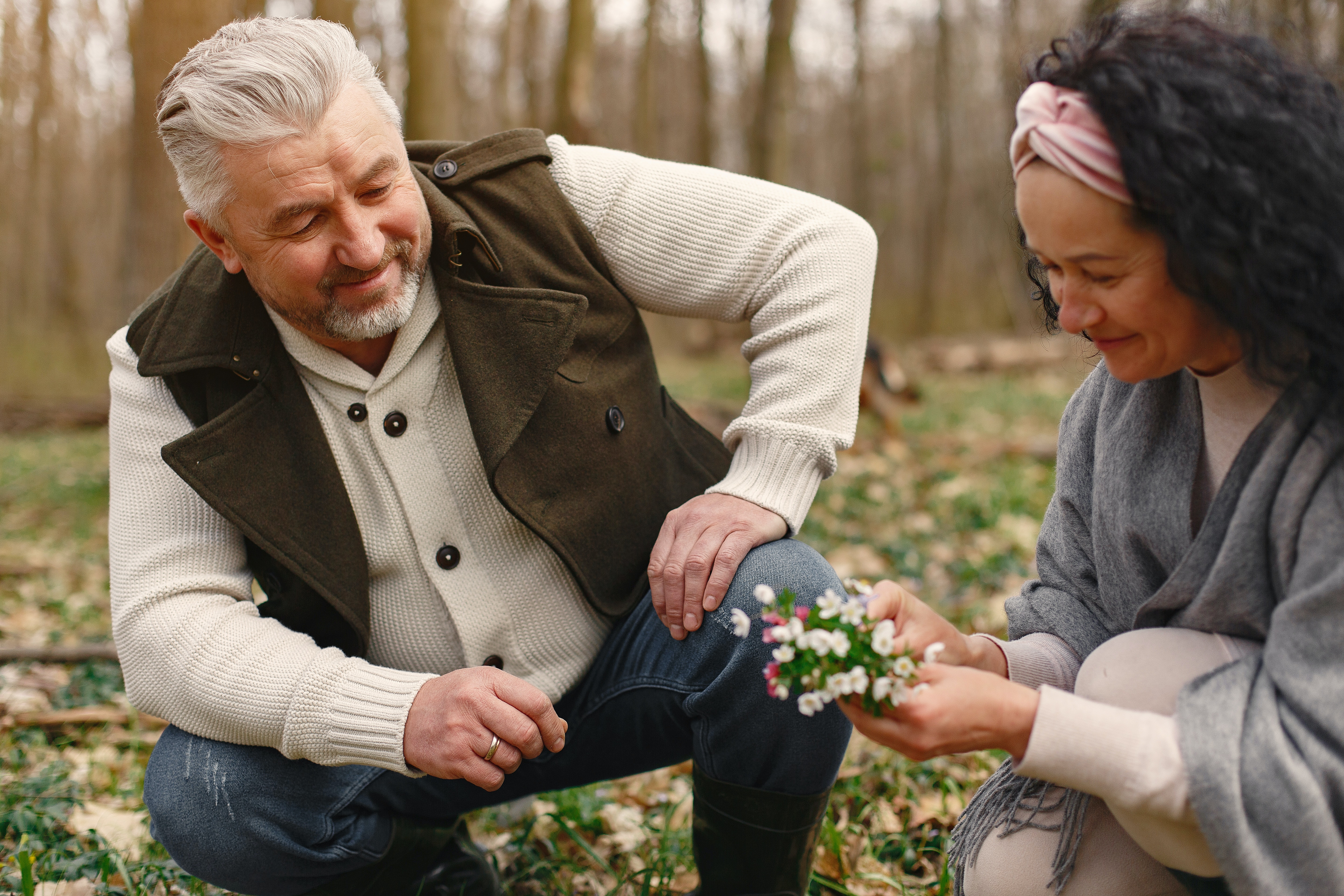 Man and a woman picking flowers