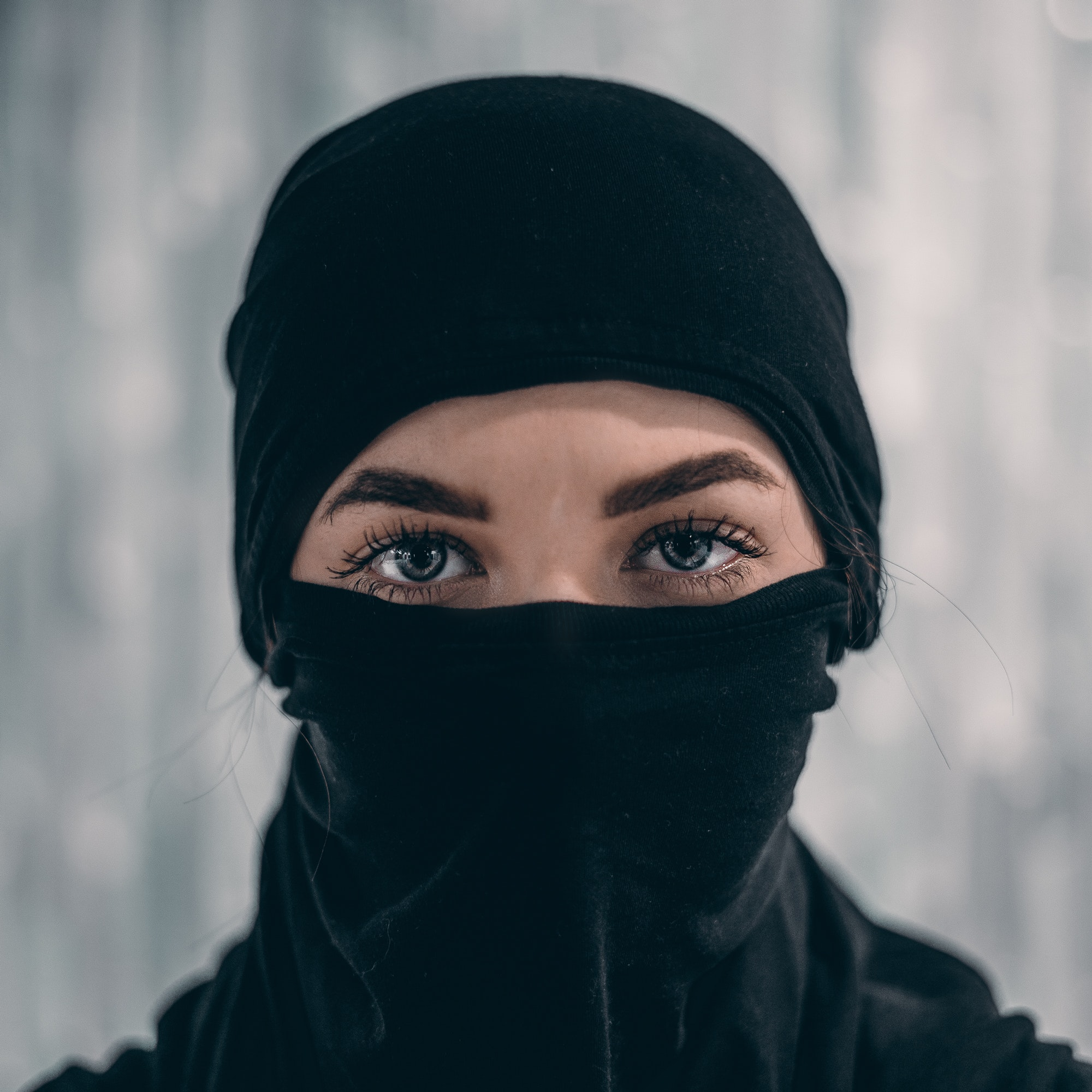 Girl wearing a full face mask with just her eyes showing