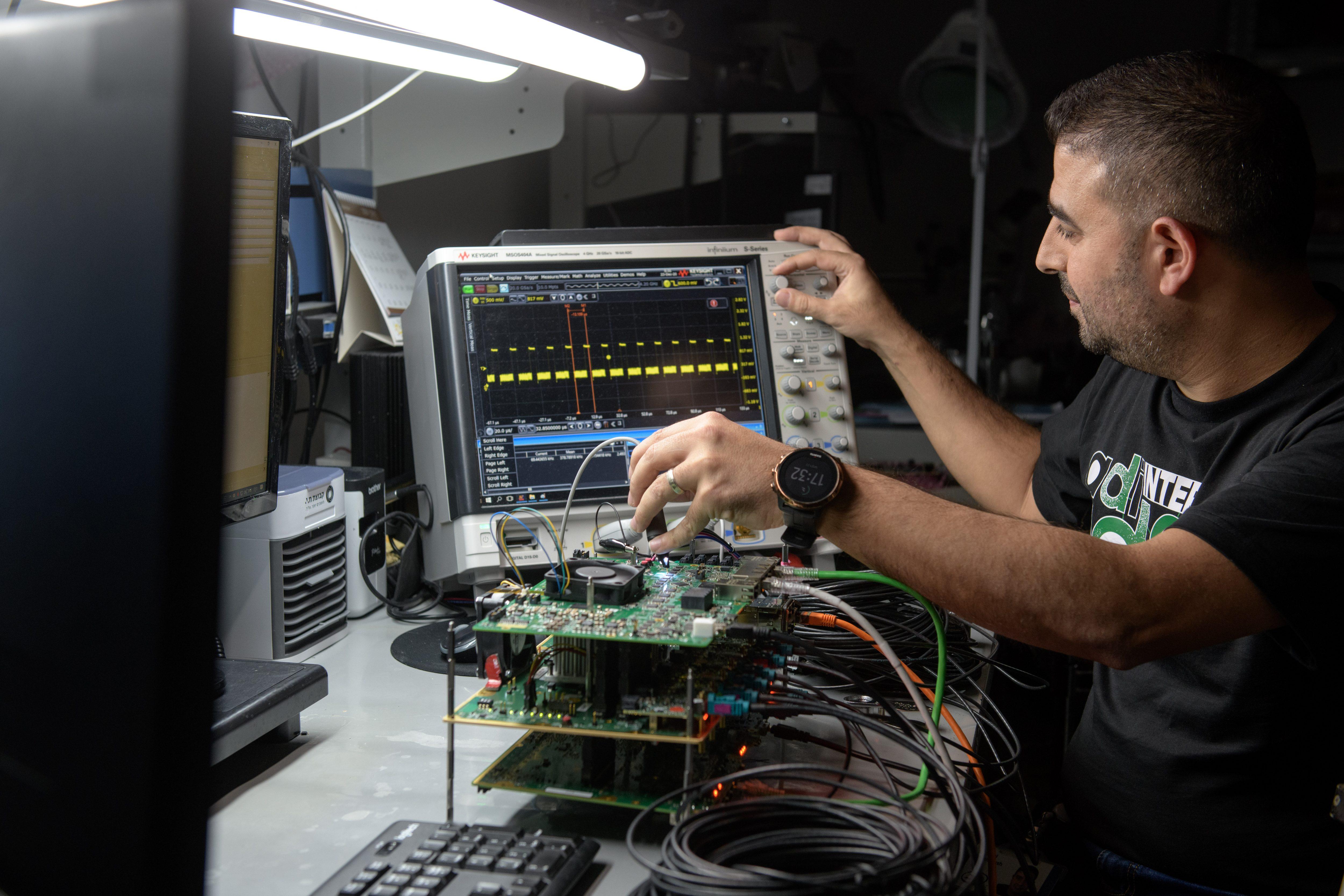 Man programming large mirco-chip