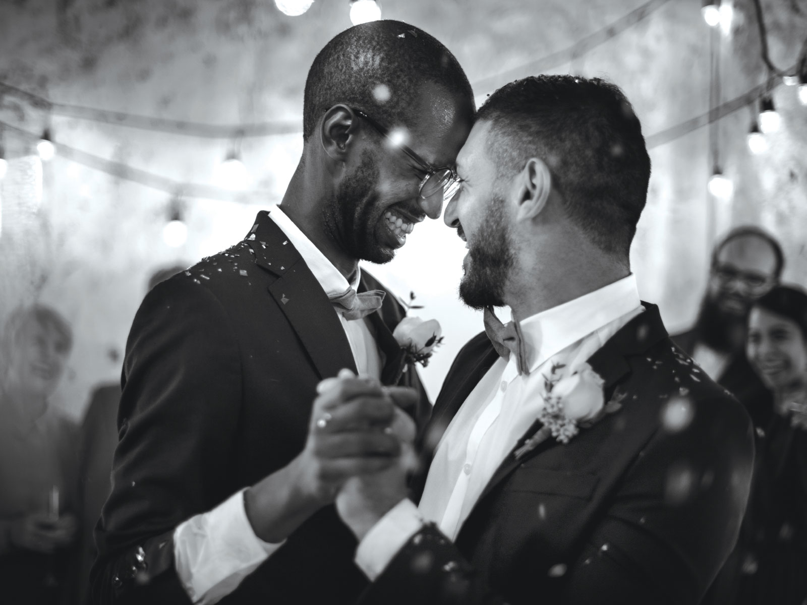 Two men dancing together at their wedding