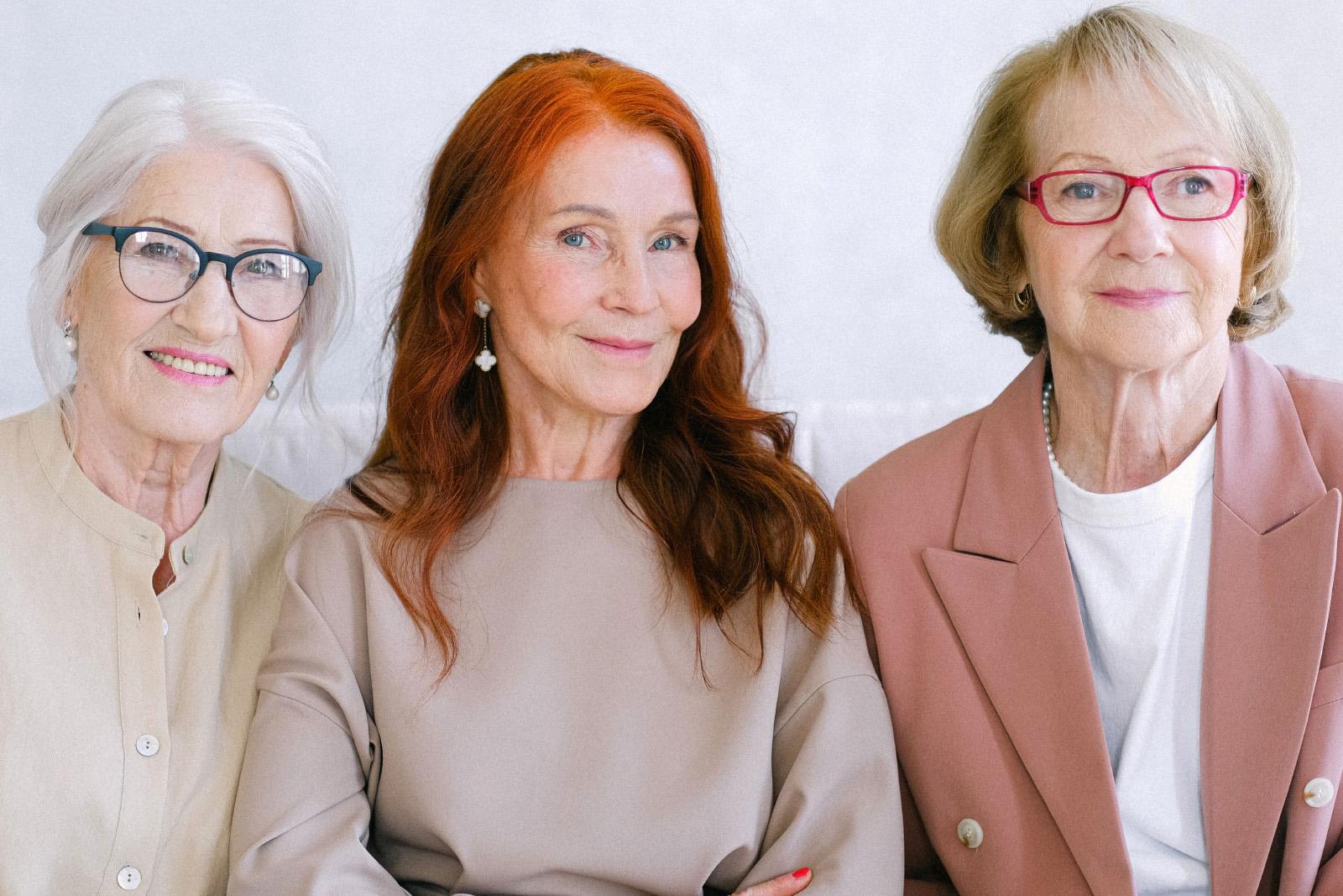 Three woman smiling at the camera