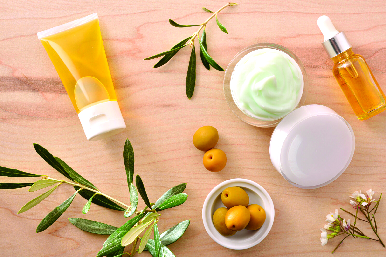 skincare products, olives and rosemary