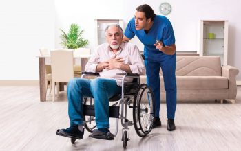 Caregiver yelling at an elderly man in a wheelchair