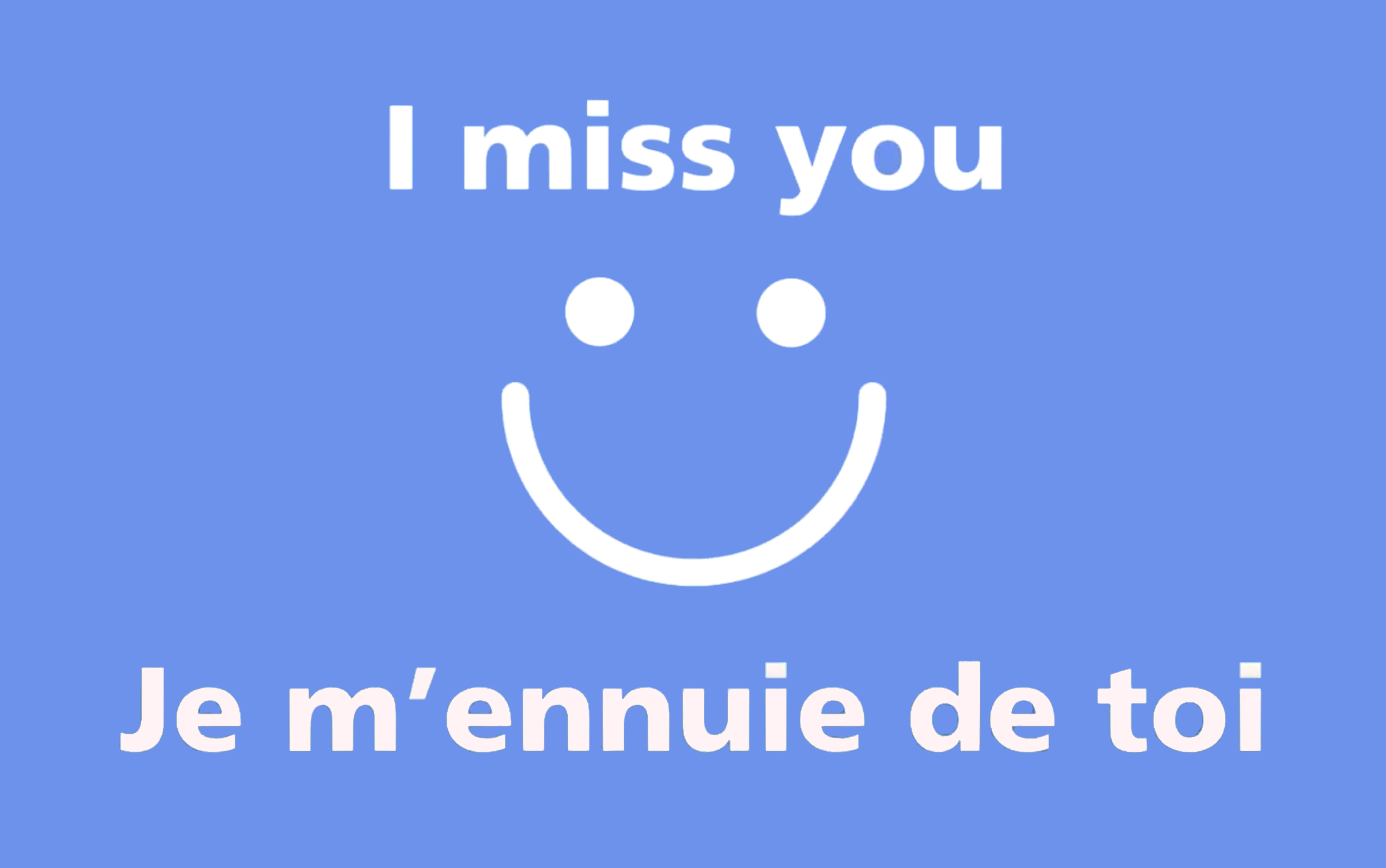 """""""I miss you"""" post card with a smiley face in the middle"""